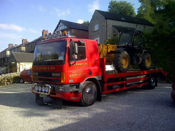 plant lorry with digger load