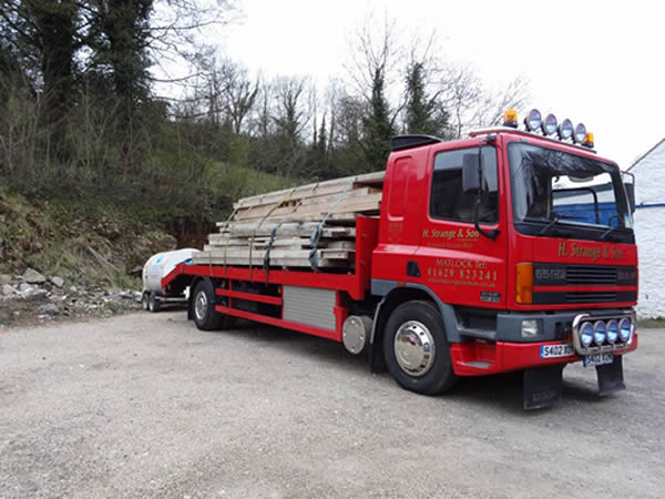 plant lorry with timber load